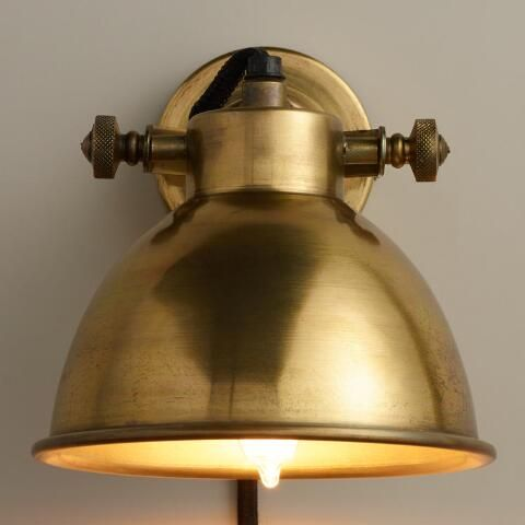 Crafted Of Iron With A Burnished Brass Finish Our Exclusive Sconce Lamp Illuminates Small Areas
