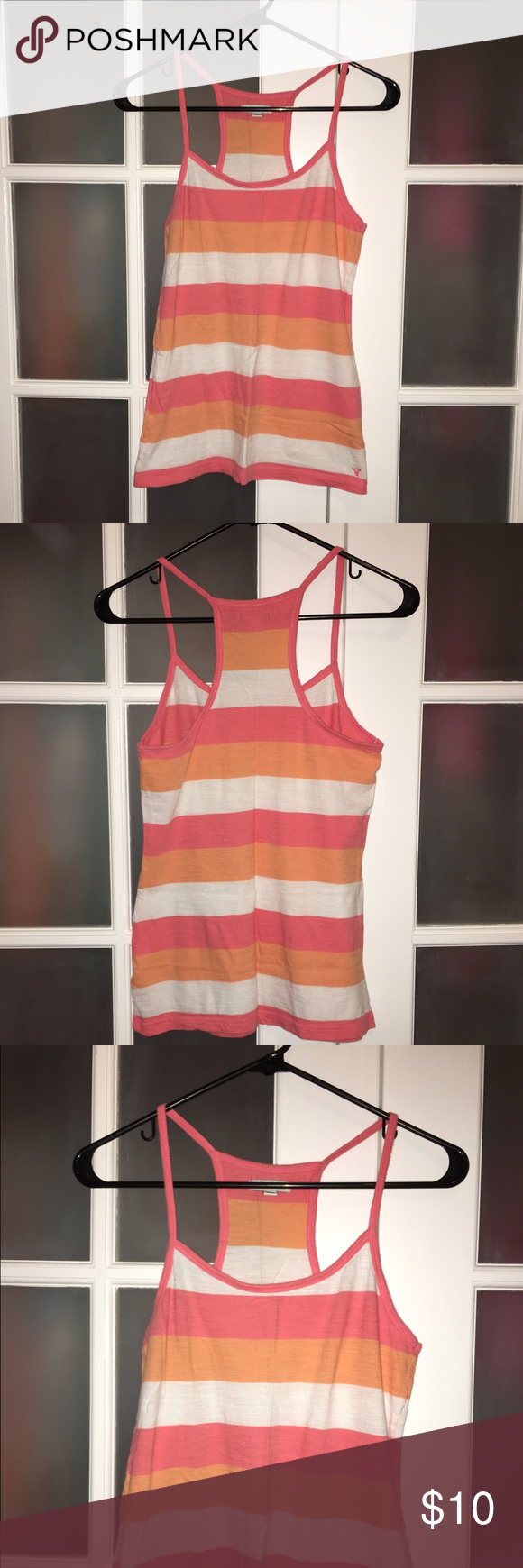 "Strapless Tank from American Eagle This is a great spaghetti strap tank from American Eagle. White, light pink and light orange stripes design. Lightweight and thin. Great to hang out in, sleep in or as a cover up over a sports bra or bikini top. U-neck. Racer back. No holes or stains. 25"" long and 26"" wide. 100% cotton. Will not shrink. Machine wash hot or cold and machine dry. Comes from a smoke free home. **No PayPal and may bundle** **NO TRADES** American Eagle Outfitters Tops Tank Tops"