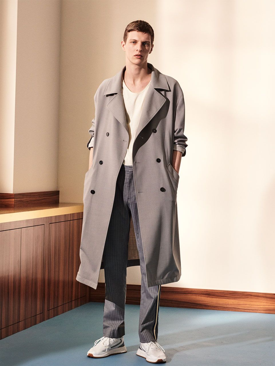 d74fd7c3721e Image 1 of OVERSIZED TRENCH COAT   PINSTRIPE TROUSERS   TECHNICAL FABRIC  SNEAKERS   BLACK LEATHER BOWLING BAG from Zara