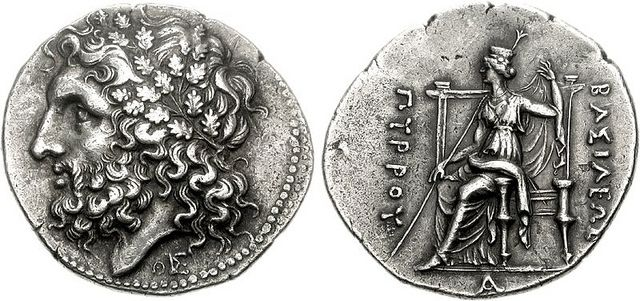 """Tetradrachm of King Pyrrhus of Epirus, Lokroi Epizephyrioi mint, c. 297-272 BC A masterpiece of Hellenistic engraving and one of the finest known. The tetradrachm shows Dodonean Zeus, whose sanctuary was at Dodona in Epirus. Epirus achieved fame during the reign of Pyrrhus, whose campaigns against Rome are the origin of the term """"Pyrrhic victory"""". Pyrrhus' army suffered irreplaceable casualties in defeating the Romans at Heraclea in 280 BC and Asculum in 279 BC during the P..."""