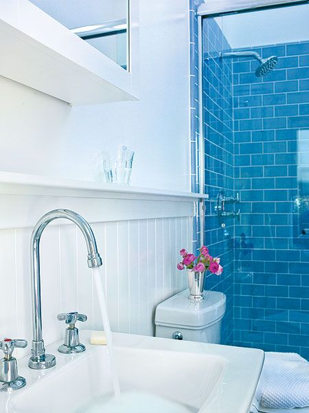 small bathroom remodeling ideas ocean blue subway tiles line the shower and give this streamlined bathroom a splash of color small room decorating ideas