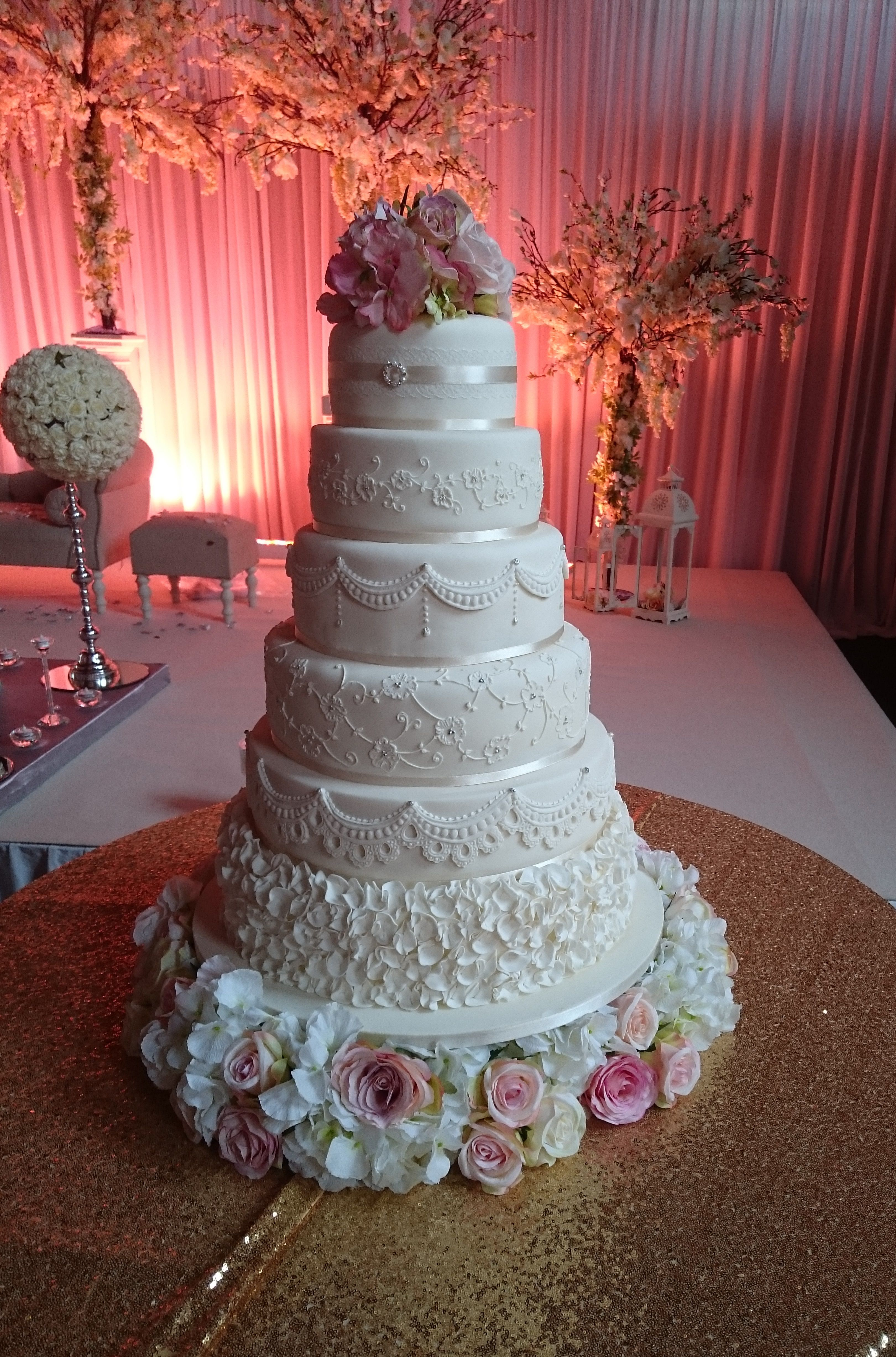 Roya, elegant 6 tiered cake decorated with lace and other effects ...