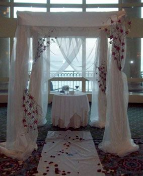 Chuppah with flowers crawling up the legs.