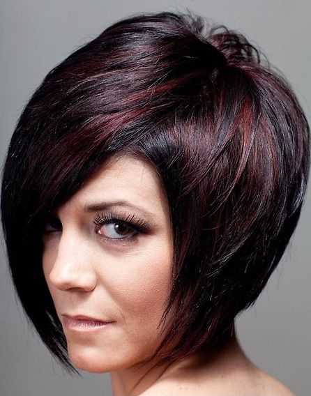 Elegant Bob Hairstyle With Brown Highlights On Black Hair