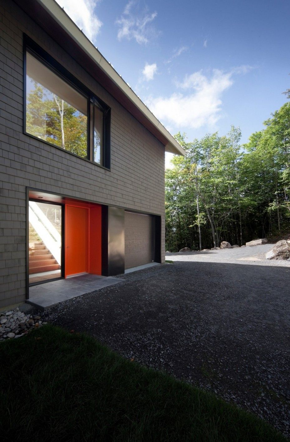 A Remodeled Traditional Cottage With Contemporary Style and Natural Surrounding : Design Modern Residence Facade With Orange Door And Glass Window With Black Frame And White Brick Wall