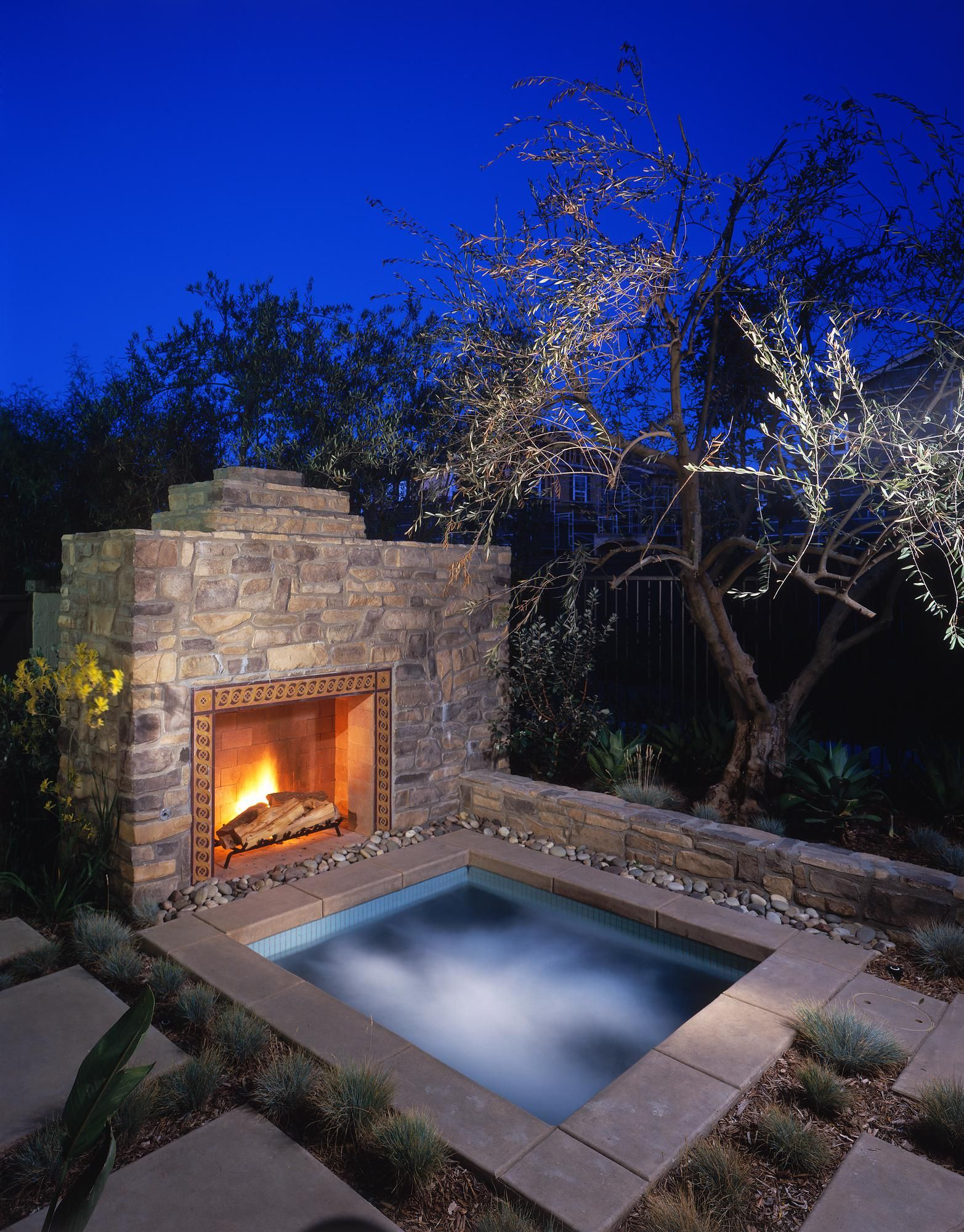 A Stone Fireplace and Hot Tub a perfect addition to any backyard