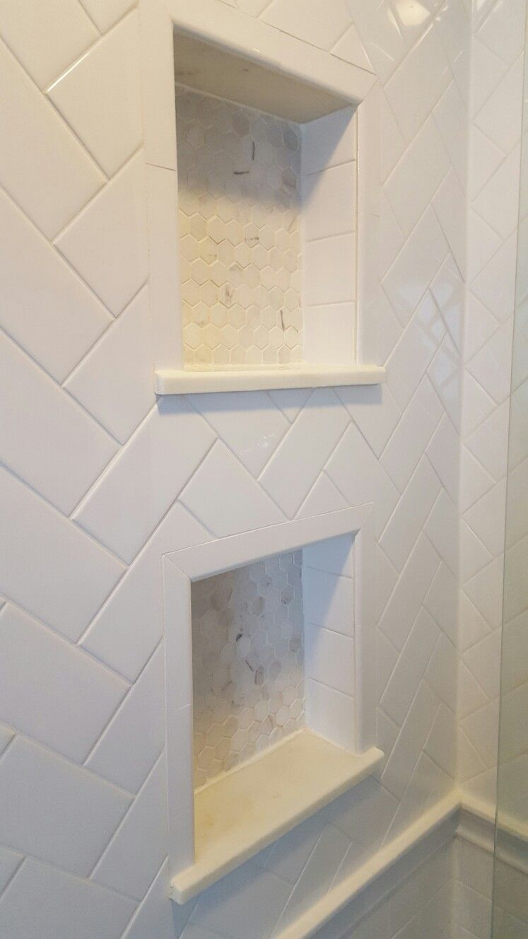 Herringbone White Subway Tile With Carrara Marble Hexagonal Tile In His And Her Shower Niches Cubbies Small Master Bathroom Small Bathroom Shower Niche
