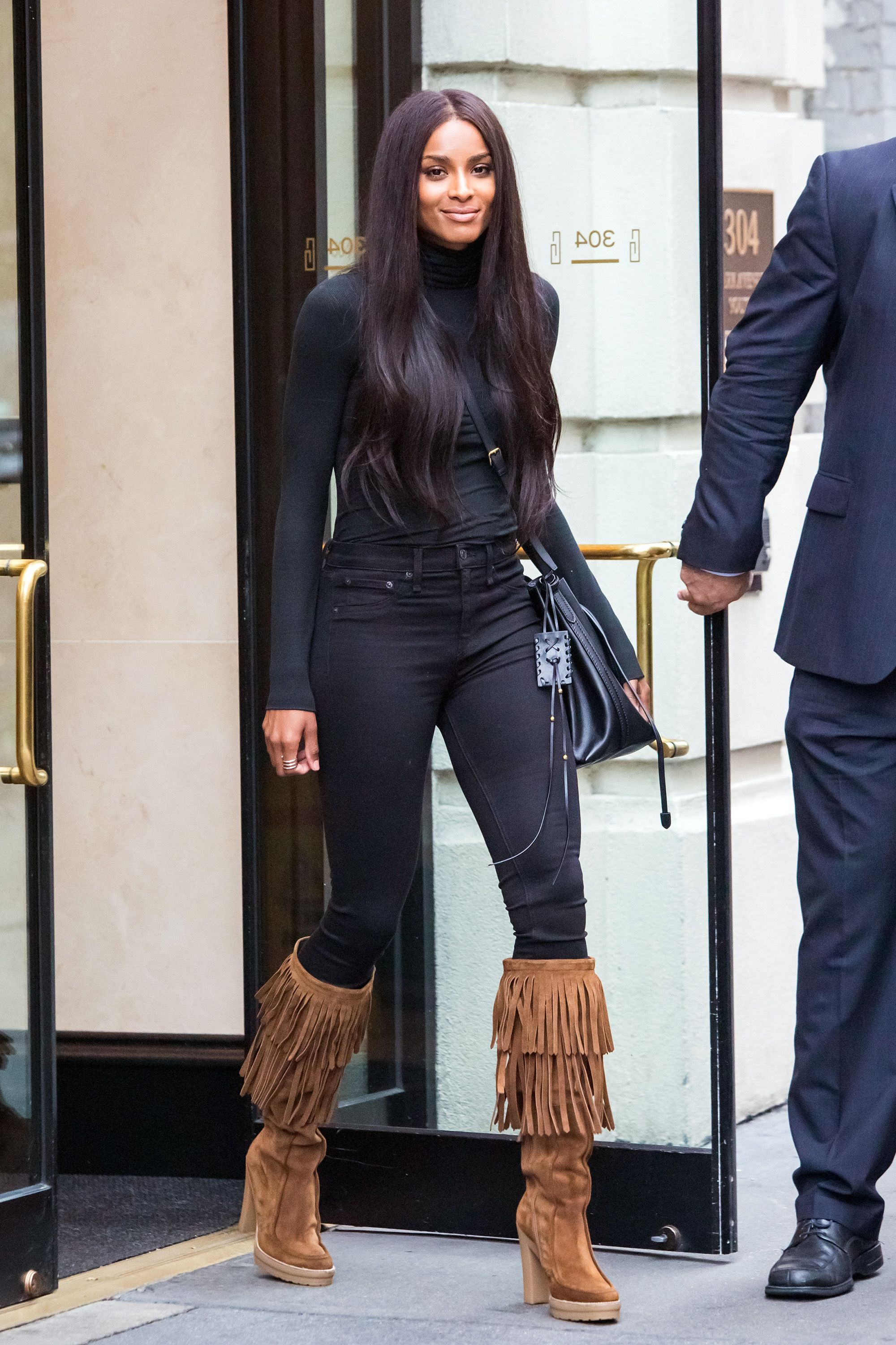 the only time i have actually liked and approved of fringe boots.