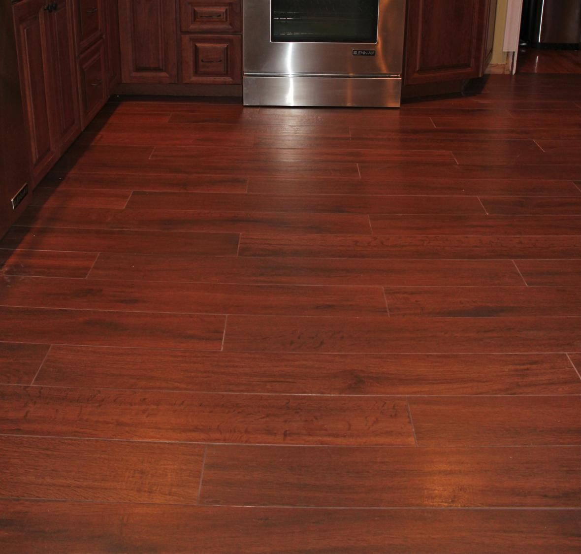 Wood ceramic tile would minimise the gap between these for Hardwood tile flooring