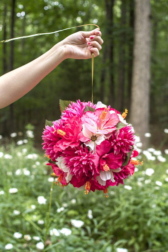 Create Your Own Custom Party Decor By Fashioning Hanging Flower Balls Out Of A Styrofoam Form Wire Ribbon And Sil Flower Ball Hanging Flowers Diy Flower Ball