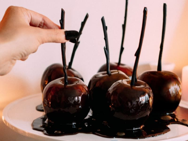 Carry the scary color scheme all the way to dessert. Put an eerie spin on a fall classic by adding black gel food coloring to your caramels. For maximum spookiness, serve while dressed up as the Evil Queen.