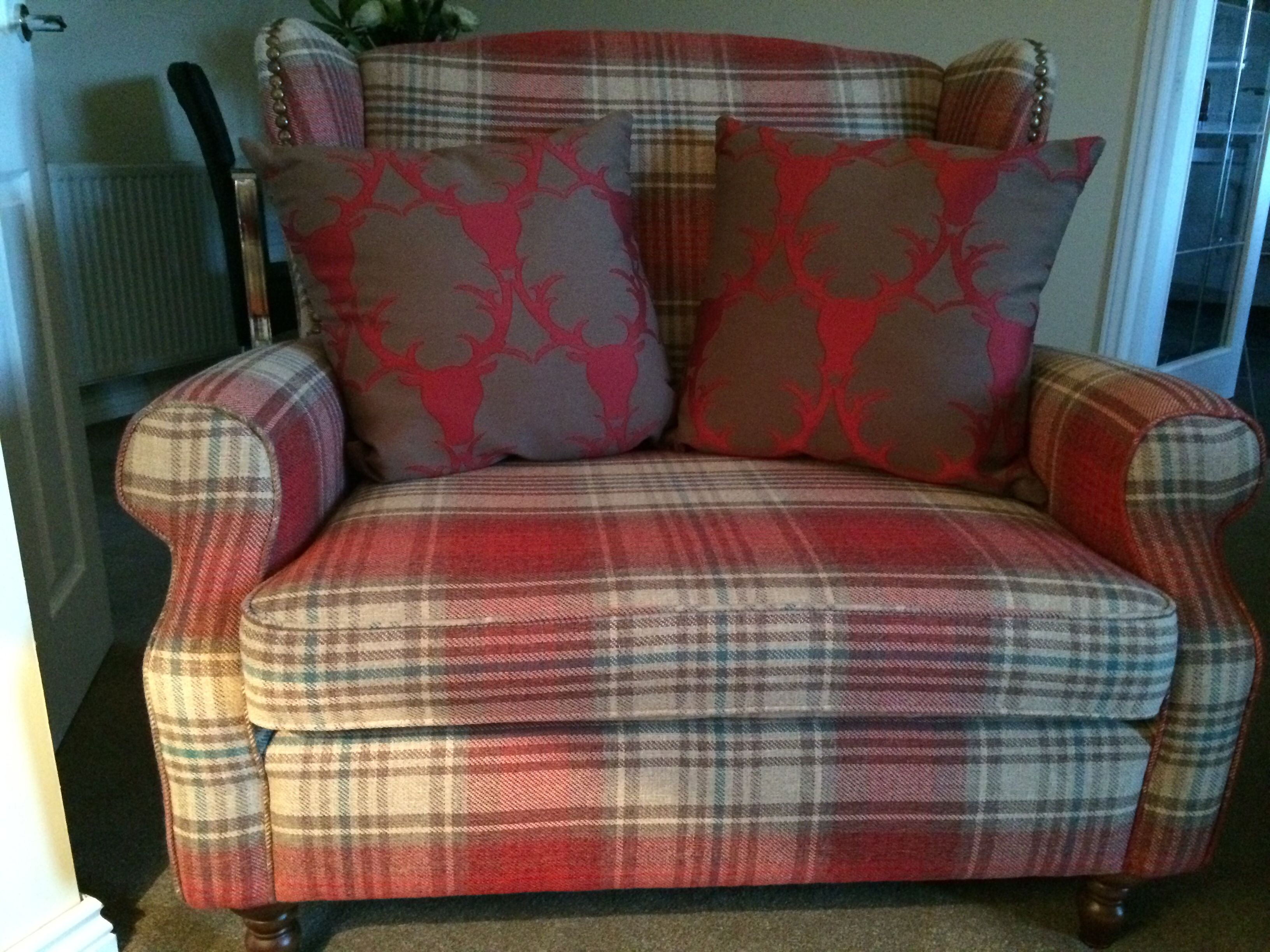 Sherlock chair £450 and footstool £199 seen in Stirling red