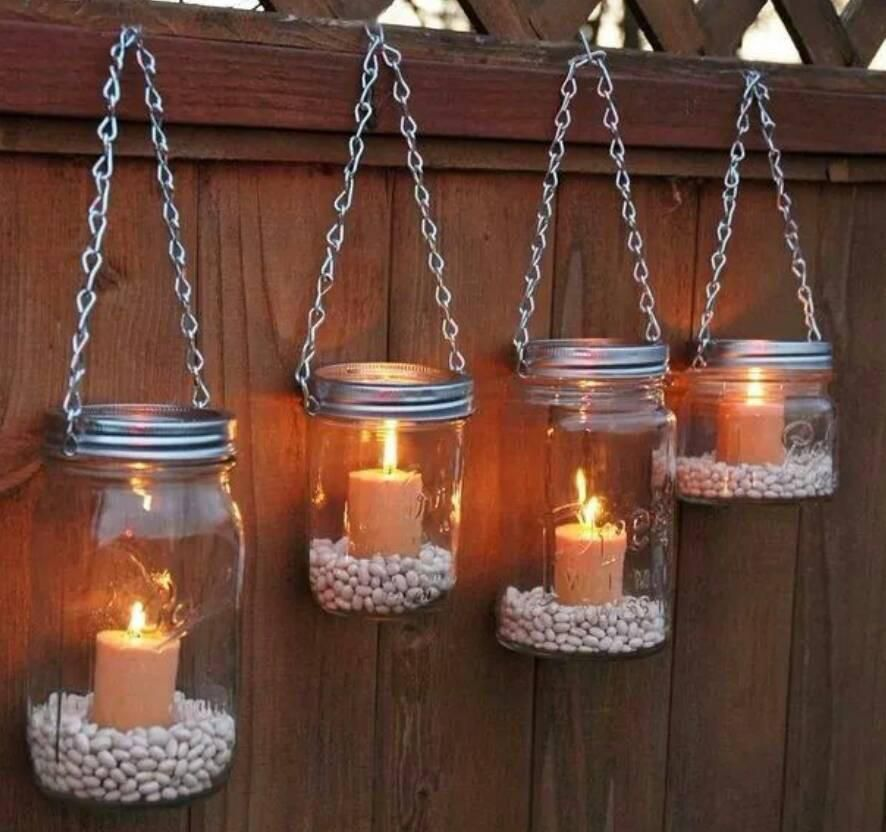 Lighting is one of the simplest ways to add appeal to your outdoor spaces and walkways. Mason Jar Candle Holder Wall Decor Garden Lighting Diy Mason Jar Garden Inspiring Outdoor Spaces