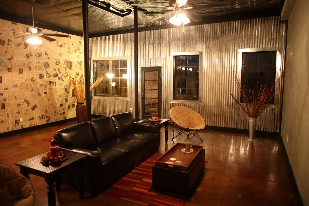 Corrugated metal wall in basement of Hoover townhome Office