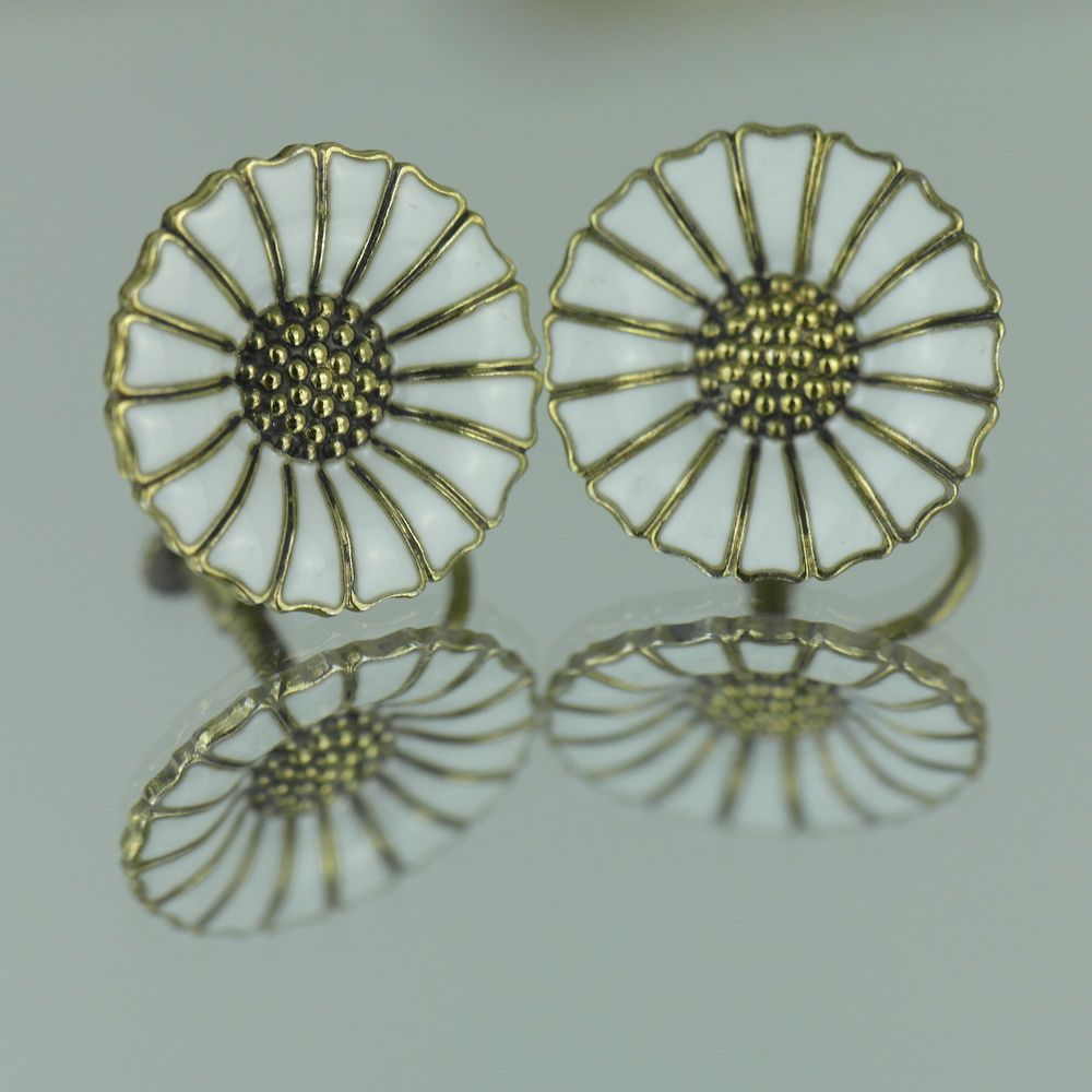 Antique gilt solid silver enamel daisy earrings story by Anton Michelsen 925S  Story: When Crown Princess Ingrid  24 May 1935 married Crown Prince Frederik, she got the brooch of his father in memory of his mother, Princess Margaretha of Sweden, who died in 1920 only 38 years old.  Shortly after Princess Margaret's birth in 1940 several prominent jewellers in Denmark produced daisy series in silver with enamel. Anton Michelsen, Volmer Bahn, Bernhard Hertz and Jysk Emblem factory made daisy…