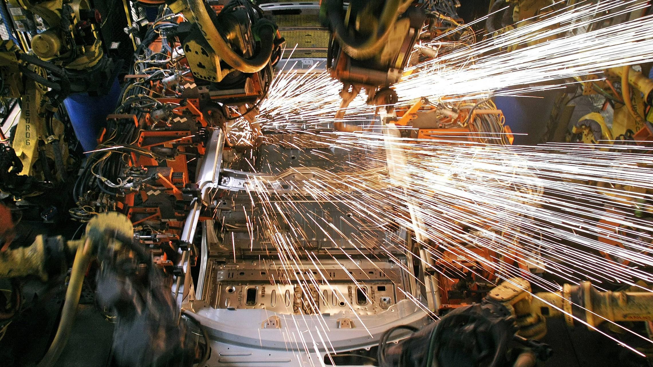 Welding at GM (Bill Pugliano/Getty Images)