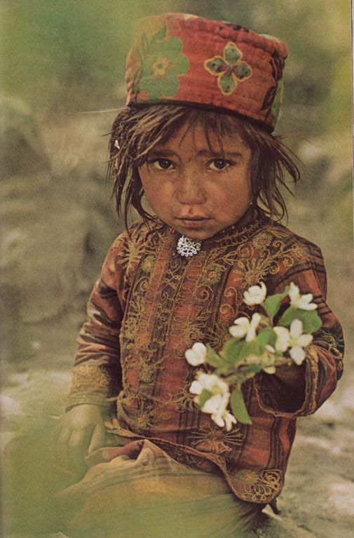 Offering Flowers. Girl in Shimshal, Upper Hunza. National Geographic November 1975.
