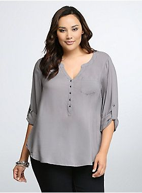 """<p>Workday-to-weekend just got so much easier. Silk-like grey challis is so comfy (you won't even want to take it off when you get home from work), but the hematite button front and tab sleeves lend just the right amount of polish for desk-duty.</p>  <p></p>  <p><b>Model is 5'10"""", size 1</b></p>  <ul> <li>Size 1 measures 29 3/4"""" from shoulder</li> <li>Rayon</li> <li>Wash cold, dry flat</li> <li>Imported plus size top</li> </ul>"""