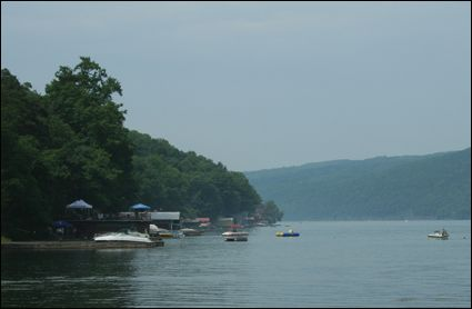 Motorboats and beach houses along Skaneateles Lake in the Finger Lakes, New York USA.
