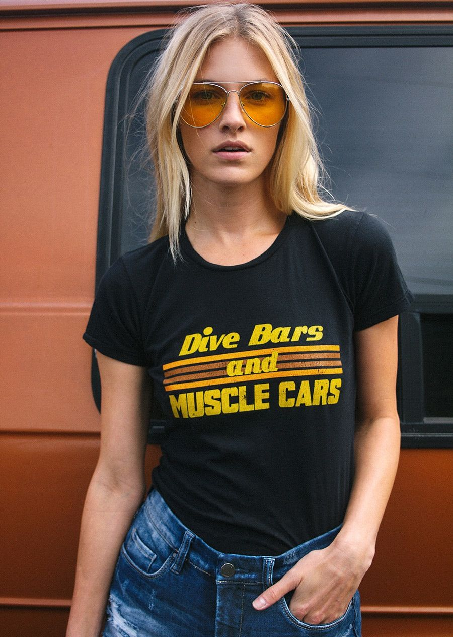 Two of our favorite things... Dive Bars and Muscle Cars. Vintage inspired and printed on super soft women's black fitted tees. 1970's inspired graphic with vintage style distressing. We sug...