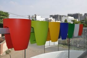 we offers plastic railing planters for growing garden plants in balcony terrace - Railing Planters