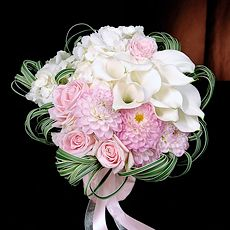 White calla lililes and pink roses and dahlias with grass ribbons - Delightful!