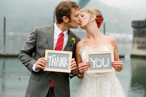Image from http://www.greenbrideguide.com/sites/default/files/bride-and-groom-holding-thank-you-sign.jpg.