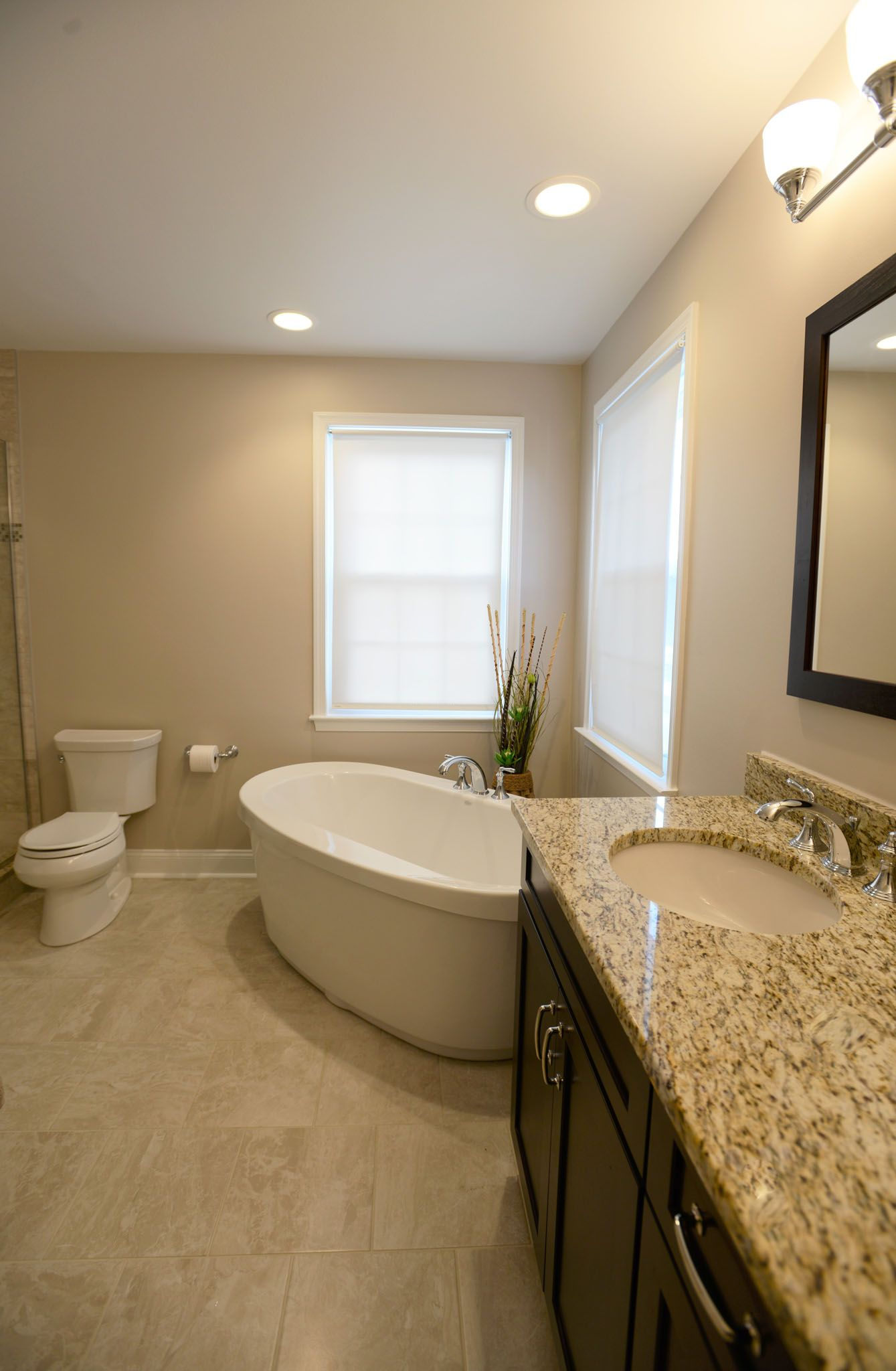 This Beige Flooring Rich Espresso Cabinets And A Beautiful Layout Create Ample Space The Warm Colors Bathroom Design L Shaped Bathroom Full Bathroom Remodel