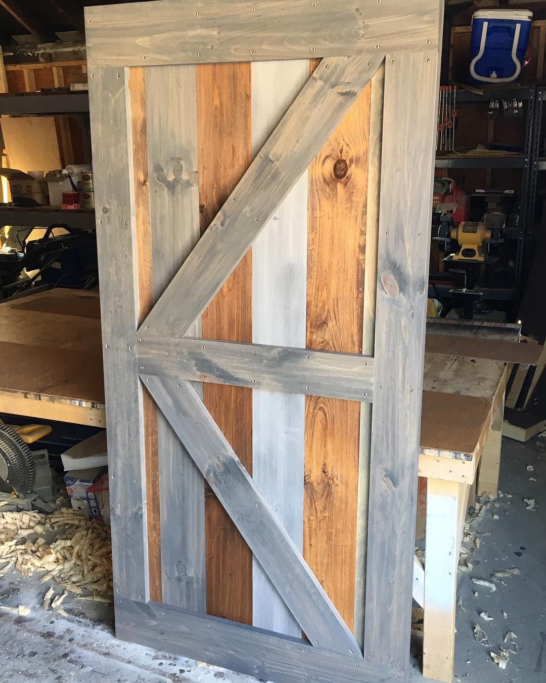 A Multi Stain Slab British Brace With Border Barn Door Is Ready To Ship Out Old Barn Doors Rustic Barn Door Rustic Doors