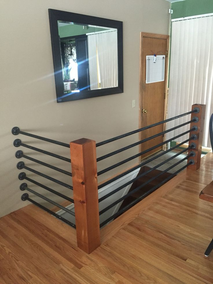 black pipe railing metal tube floor flanges and black pipe support poles were made with 6x6 red cedar diy banister