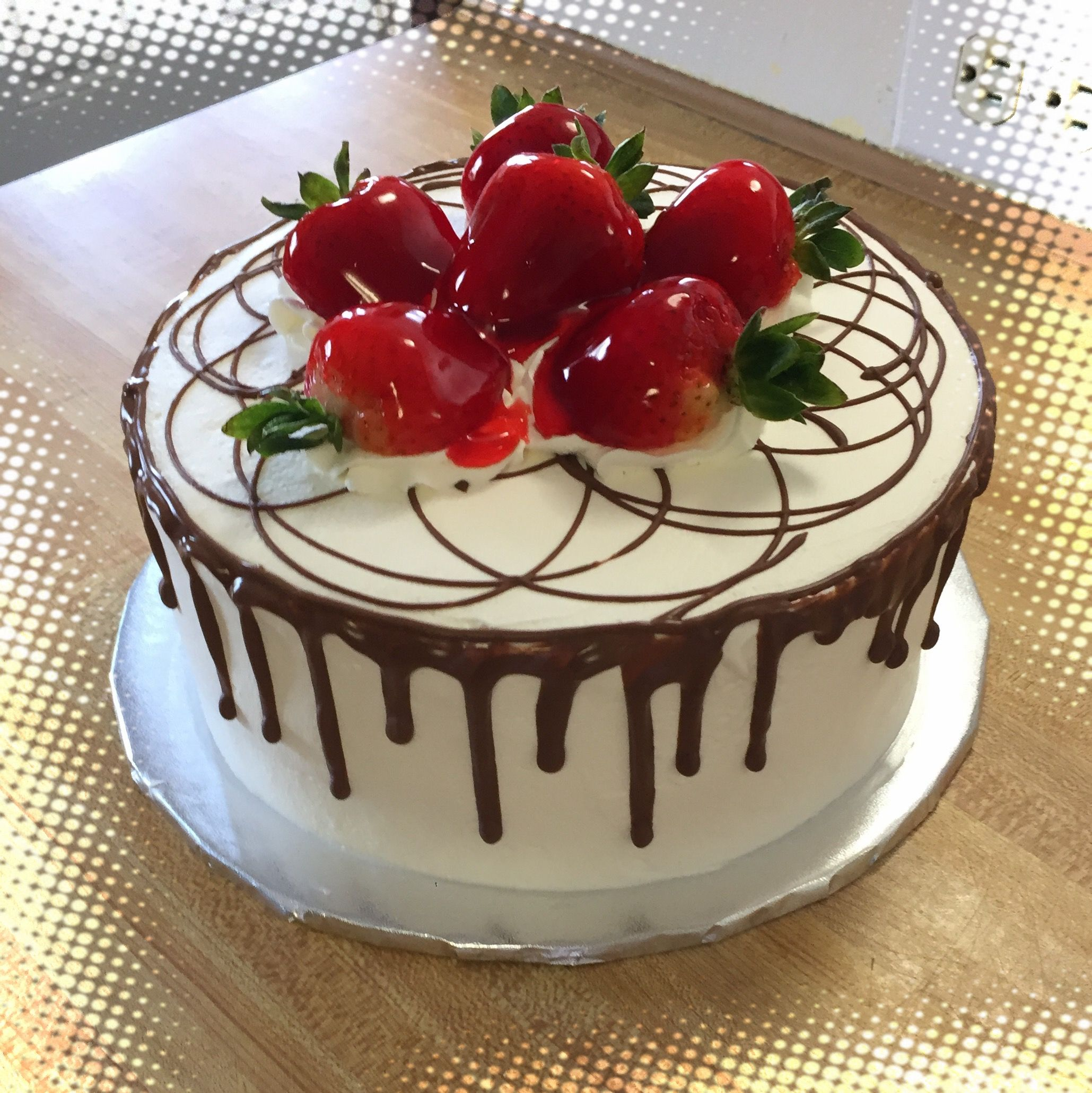 Tres Leches Cake Garnished With Strawberries And Drizzled With
