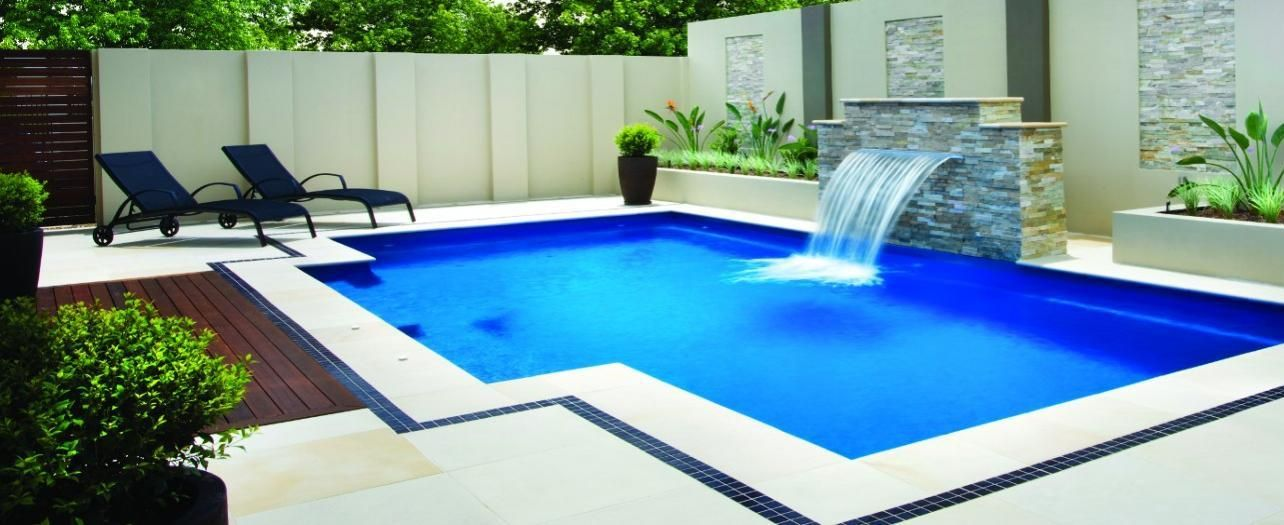 Pool awesome waterfall in swimming pool with natural for Outdoor pool decorating ideas