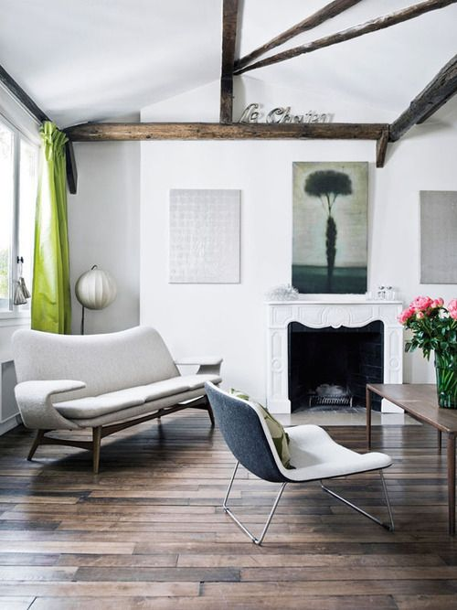 Nice exposed beams and hardwood floor in this living room. Pop of lime green in the curtains brightens the neutral palette. #livingroom #decor #interiordesign