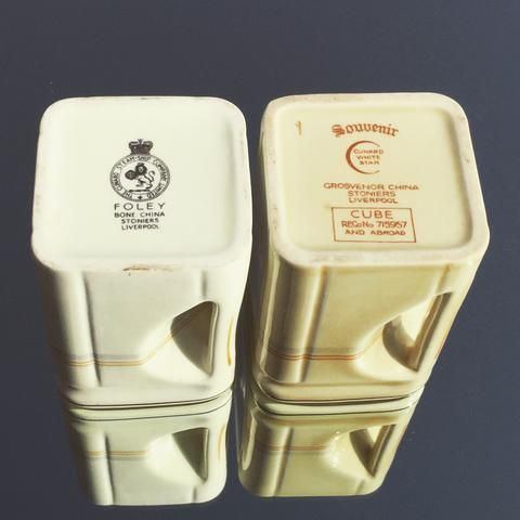 Left, c-1950's pale ivory cube milk jug. Right, c-1936 the far richer dark ivory tone as originally intended for the ships service. This example showing one of the rarely seen 'Souvenir' examples, the two clearly showing the differing colours.