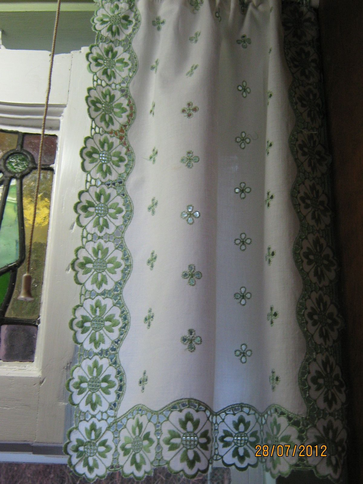 Made curtains from a table runner purchased at yard sale