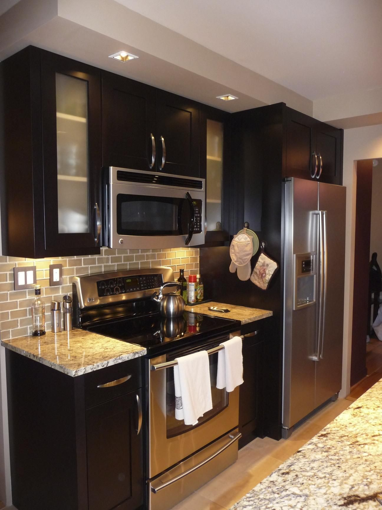 Small Kitchen Countertop Espresso Cabinets With Stainless Steel Appliances And Backsplash