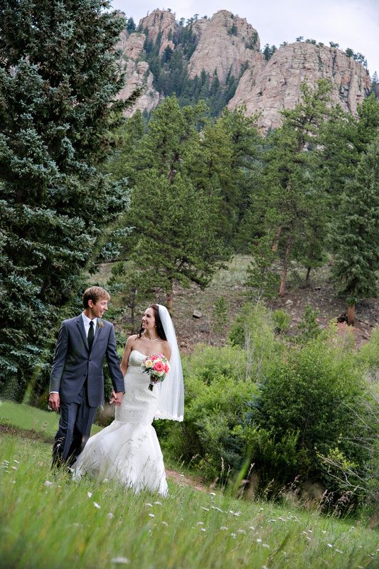 Amazing background landscape with Gorgeous Vibrant Mountain Wedding. Bride in a beautiful mermaid gown and groom in a handsome grey suit. Wedding at Lower Lake Ranch, Evergreen, CO Matt & Kara Photos by Katie Corinne Photography