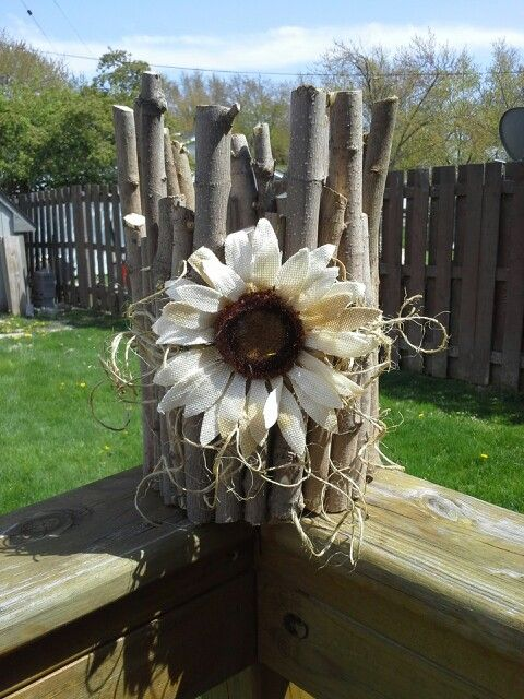 Coffee can repurposed. Hot glue some yard clippings Add some string and a dollar store flower = a cute planter on the cheap!