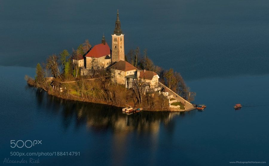 Floating Outpost - Pinned by Mak Khalaf A close up shot from a high vantage point of the island on lake Bled in Slovenia. Feel free to follow me on FACEBOOK or to visit my WEBSITE Landscapes lakechurchislandclose upsloveniabledlake bled by alexriek