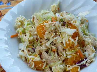 CRUNCHY ASIAN CHICKEN SALAD  Dressing  1/3 cup canola oil  1/3 cup rice vinegar  1 TBSP teriyaki sauce  3 TBSPs sugar  3/4 tsp salt  1/2 tsp pepper  Salad  2 cups chicken, cooked and shredded  1 package (3 oz) ramen noodle soup mix (any flavor)  1 bag (16 oz) coleslaw mix (shredded cabbage and carrots)  4 medium green onions, sliced (1/4 cup)  1/2 cup sliced almonds (2 oz)  2 small cans mardarin oranges, drained  Toasted sesame seeds for garnish, optional