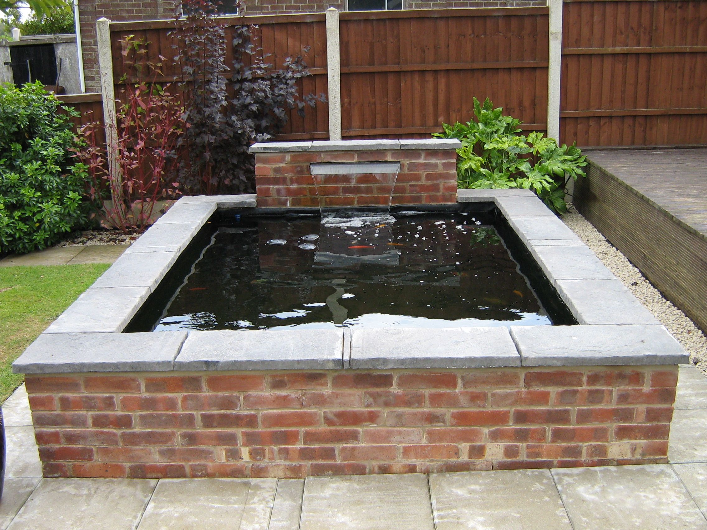 Koi pond construction google search zahrada for Raised koi pond ideas