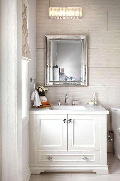 white and taupe bathroom features light taupe tiled walls