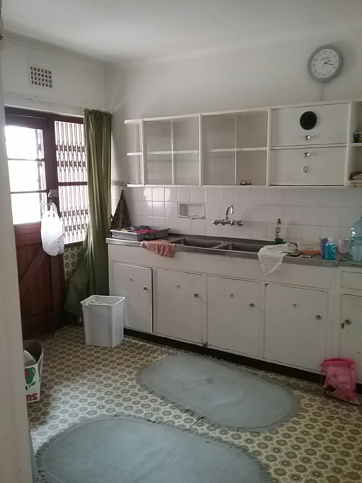 """Kitchen with very old brittle """"lino"""" flooring. With paint scrappers we managed to lift this all off (20sqm) in about 2 hrs"""