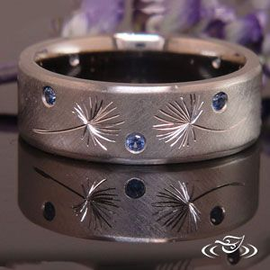 Engraved dandelion seed ring with blue sapphires <3