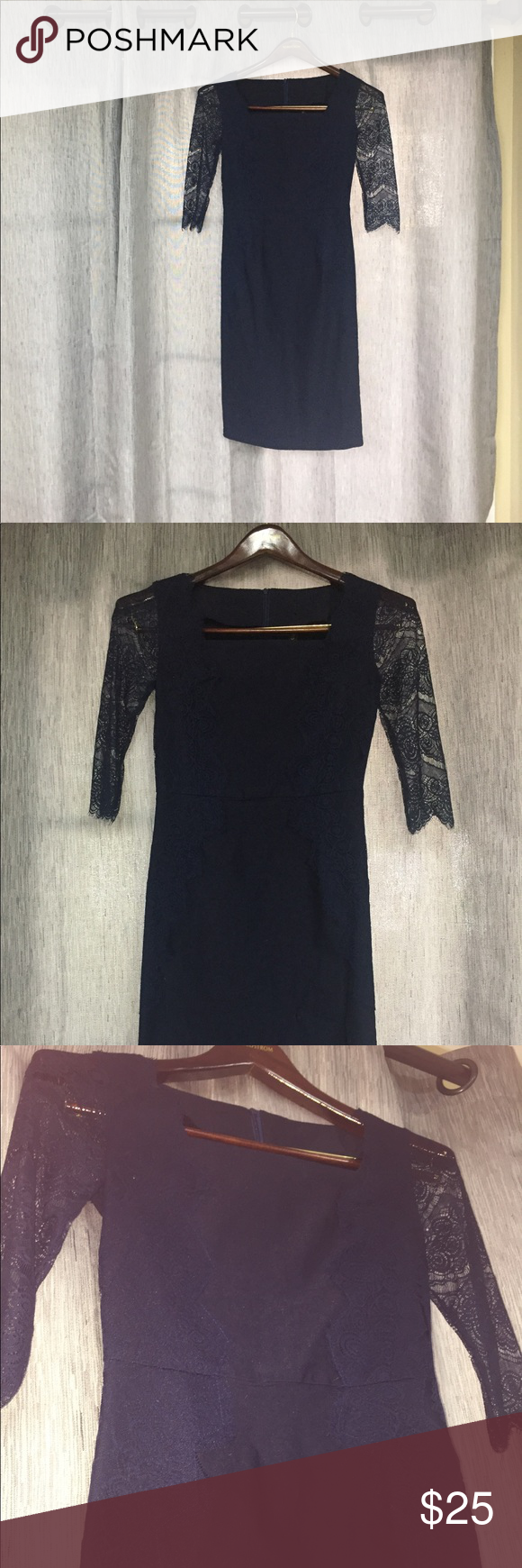 Lace below knee dress  Stunning Navy Dress with Lace Sleeves and Details I love this dress
