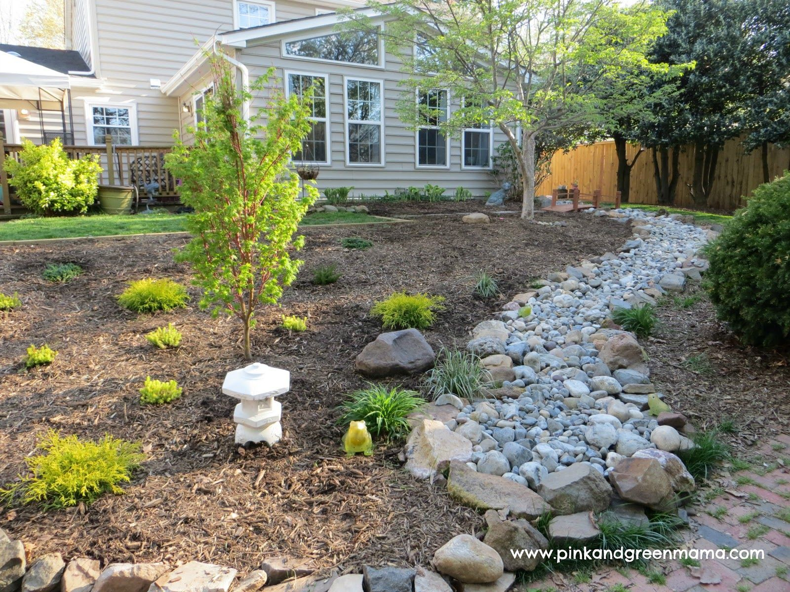 diy dry river bed backyard makeover on a budget from pink and