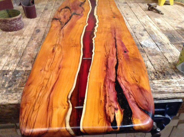 Elegant Coffee Table Top With Amber Resin Flowing Through The Wood.