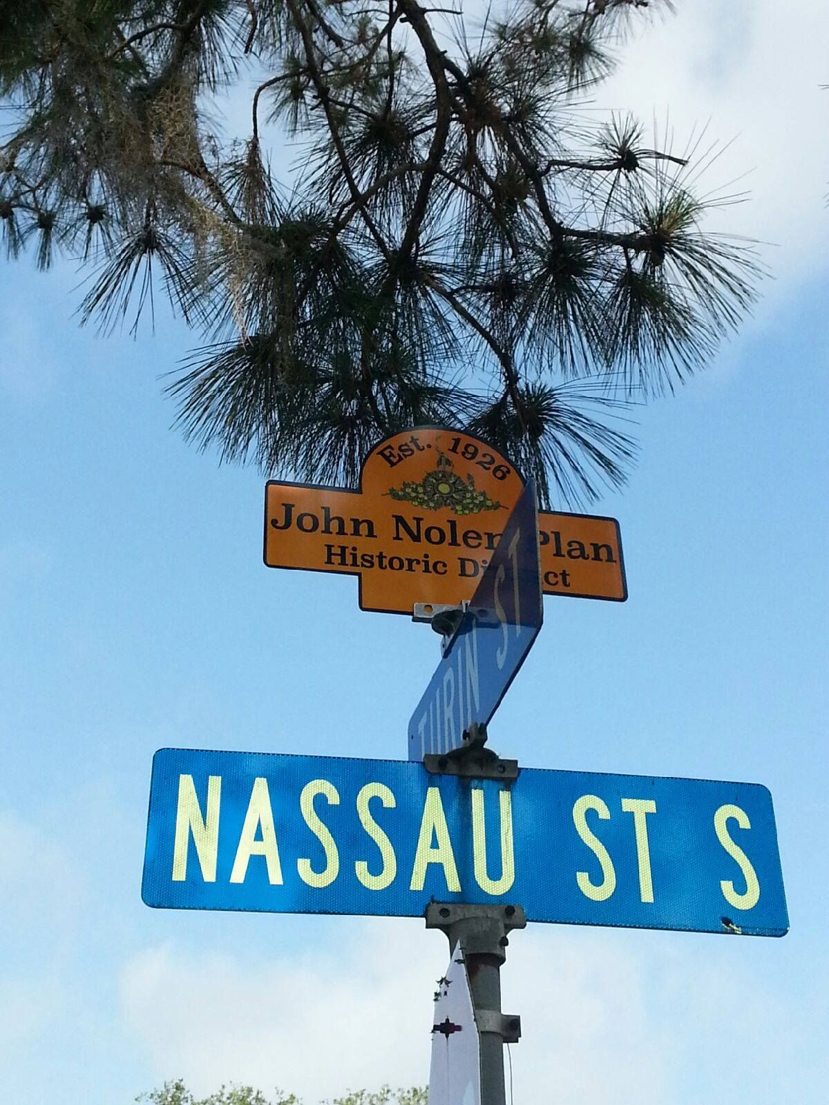 The street sign toppers are posted to identify the John Nolen Plan ...