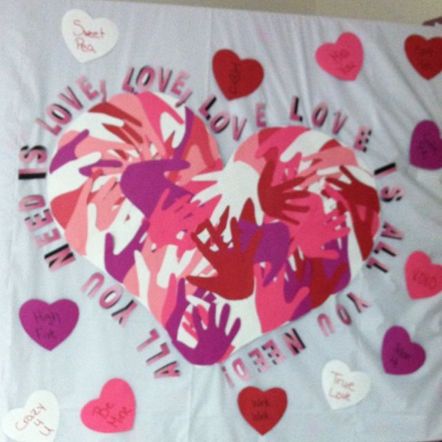 Valentine's Day bulletin board for my classroom at work :) The heart is made out of handprints of all of the kids #valentines day bulletin board elementary #valentinesdaybulletinboardideas