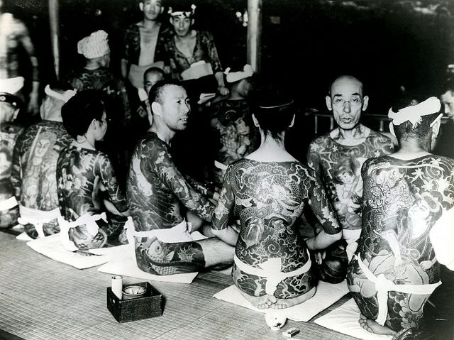 "Tattoo Convention - Tokyo 1934    ""Japanese Tattoo Enthusiasts Convene in Tokyo – Men and women bearing unusual tattoo designs on their skins recently convened in Tokyo, Japan, where many curious [people came to] view the strange designs. Tattooing has been forbidden in Japan by law for the past twenty years. Above are some of the leading delegates to the convention."" Credit Line (ACME) 9/9/34. Vintage Press photo and Press release."